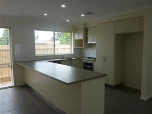 After photo of kitchen in Sale. Modern finishes and open design